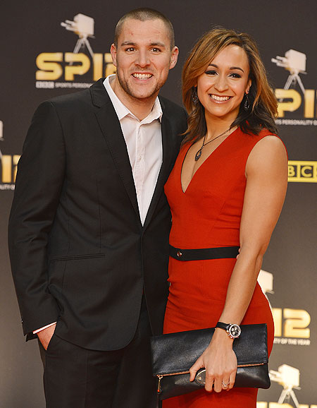 British heptathlete Jessica Ennis and her partner Andy Hill arrive for the Sports Personality of the Year 2012 awards ceremony