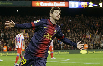 Barcelona's Lionel Messi celebrates scoring against Atletico Madrid during their La Liga match on Sunday