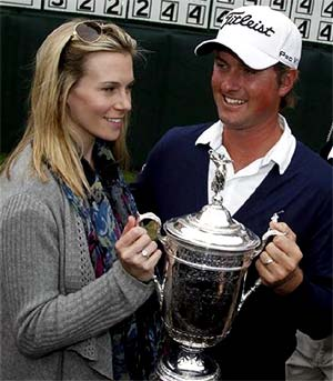 American golfer Webb Simpson celebrates with wife
