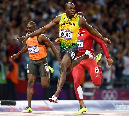 Usain Bolt crosses the finish line to clinch the 100m gold