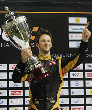 Driver Romain Grosjean from Team France holds up Race of Champions (ROC) trophy after winning on Sunday