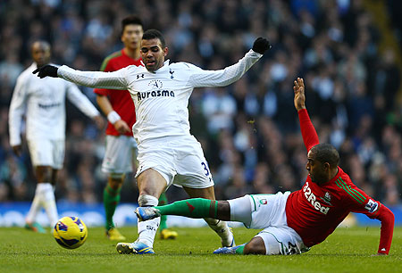Kemy Agustien of Swansea City tackles Sandro of Tottenham Hotspur on Sunday