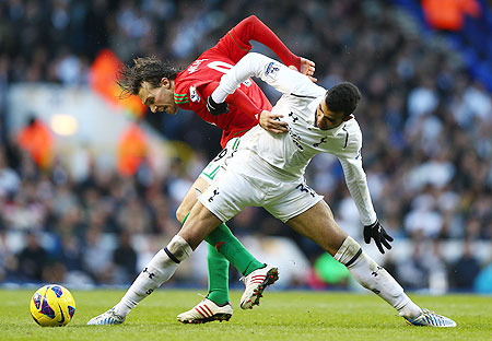 Michu of Swansea City and Sandro of Tottenham Hotspur battle for the ball during their match on Sunday