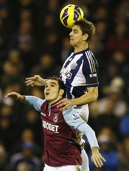 West Bromwich Albion's Zoltan Gera (right) and West Ham United's Joey O'Brien are involved in an aerial challenge on Sunday