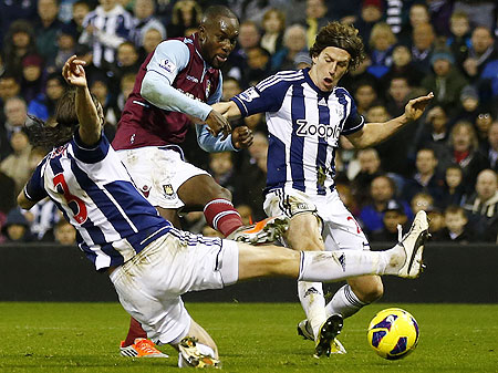 West Ham United's Carlton Cole (cole) is challenged by West Bromwich Albion's Billy Jones (right) and Jonas Olsson during their match on Sunday
