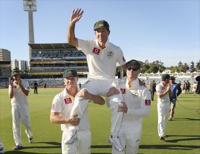 Australia's Ricky Ponting is carried off the WACA in Perth by team mates David Warner (L) and captain Michael Clarke after the third Test cricket match against South Africa