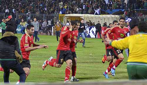 Al Ahli Soccer players try to leave the stadium as chaos erupts at a soccer stadium in Port Said city