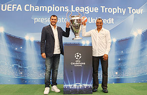 Former Italian footballer Christian Vieri and Brazil's World Cup winning captain Cafu pose with the UEFA Champions League Trophy during the Trophy Tour 2012/13