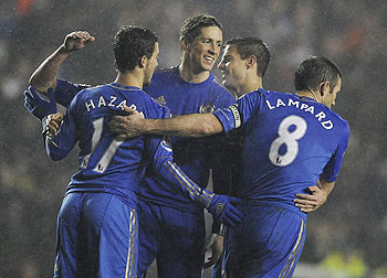 Chelsea's Fernando Torres (centre) celebrates with teammates after scoring during their English League Cup quarter-final against Leeds United on Wednesday