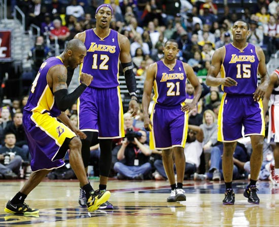Kobe Bryant celebrates with his Los Angeles Lakers team-mates
