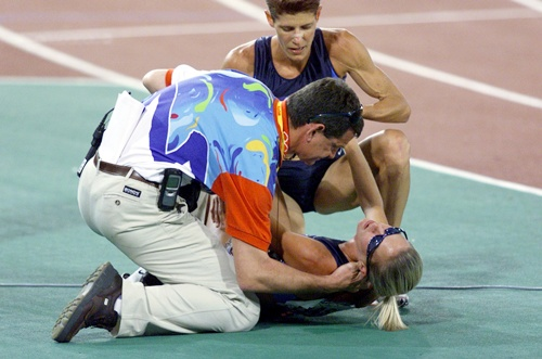 Suzy Favor Hamilton of the USA is attended to by a doctor