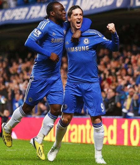 Fernando Torres of Chelsea (right) celebrates with Victor Moses