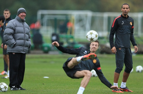 Sir Alex Ferguson jokes with Rio Ferdinand during the Manchester United Training
