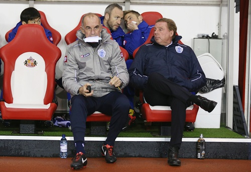 Queens Park Rangers manager Harry Redknapp sits next to his assistant manager Joe Jordan
