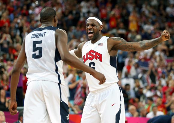 Kevin Durant and LeBron James of the United States celebrate winning the men's Basketball gold medal