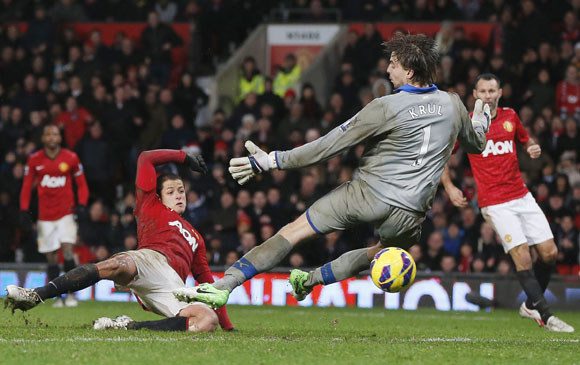 Manchester United's Javier Hernandez (L) scores past Newcastle United's Tim Krul at Old Trafford