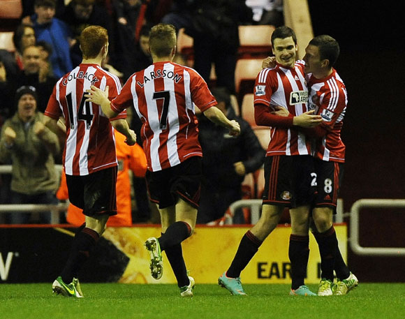 Sunderland's Adam Johnson (2nd R) celebrates scoring against Manchester City with teammates
