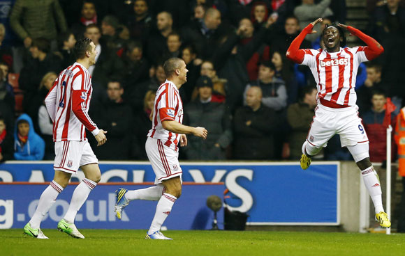 Stoke City's Kenwyne Jones (R) celebrates after scoring during their match against Liverpool at The Britannia stadium