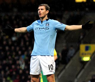 f5e331b41 Edin Dzeko shone to give 10-man Manchester City a battling 4-3 victory at  Norwich City but leaders Manchester United also won as own goals and more  ...