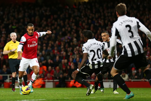 Theo Walcott of Arsenal scores