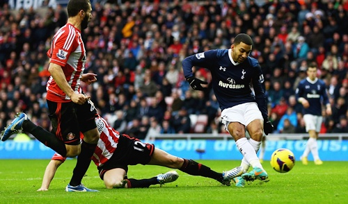 Aaron Lennon of Tottenham scores his teams second goal