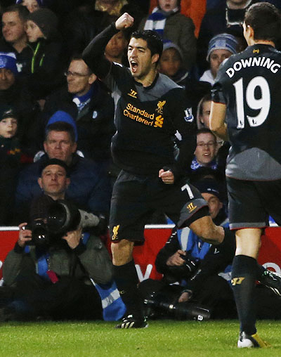 Liverpool's Luis Suarez celebrates after scoring against Queens Park Rangers on Sunday