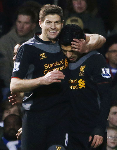 Liverpool's Luis Suarez (right) celebrates with teammate Steven Gerrard after scoring against Queens Park Rangers