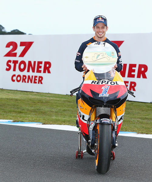 Casey Stoner of Australia and Honda Team poses with the 'Stoner Corner' trophy
