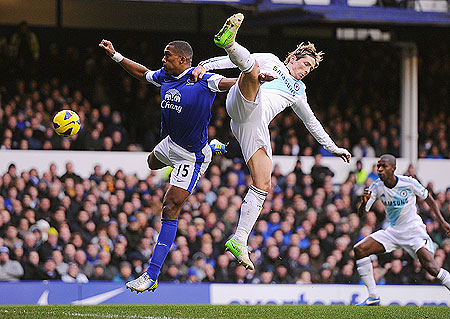 Sylvain Distin of Everton and Fernando Torres of Chelsea vie for possession during their Premier League match on Sunday