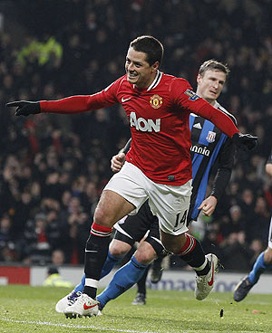 Manchester United's Javier Hernandez (left) celebrates after scoring against Stoke City during their EPL match on Tuesday