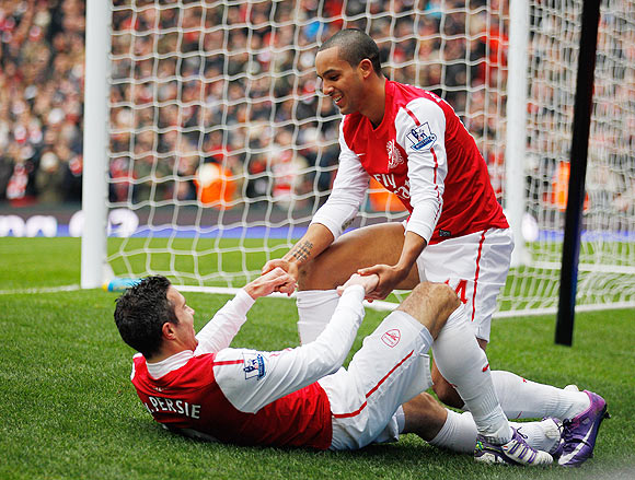 Theo Walcott and Robin van Persie of Arsenal celebrate