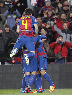 Barcelona players celebrate after scoring