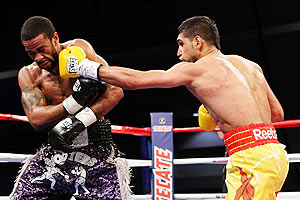 Amir Khan connects with a left punch to the head of Lamont Peterson