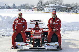 Formula One drivers Fernando Alonso (right) and Felipe Massa pose near the new Ferrari Formula1 F2012 car
