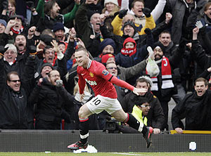 Wayne Rooney celebrates after scoring against Liverpool on Saturday