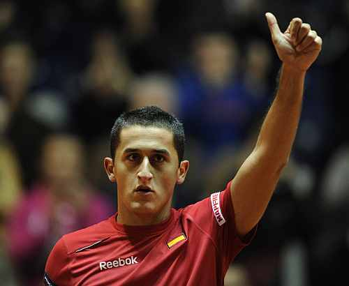 Spain's Nicolas Almagro celebrates after beating Kazakhstan's Evgeny Korolev during their Davis Cup match in Oviedo