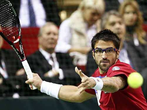 Janko Tipsarevic of Serbia hits a return to Prpic of Sweden during their match at the Davis Cup tennis tournament in Nis