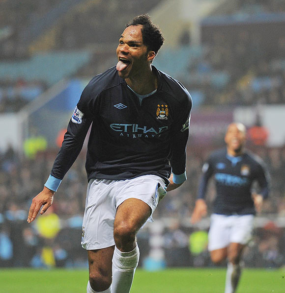 Joleon Lescott of Man City celebrates after scoring against Aston Villa on Sunday