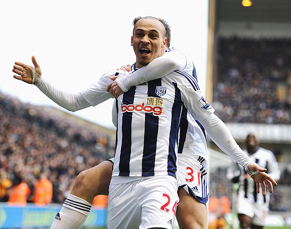 Peter Odemwingie of West Bromwich celebrates with teammate Simon Cox after scoring against Wolverhampton Wanderers on Sunday