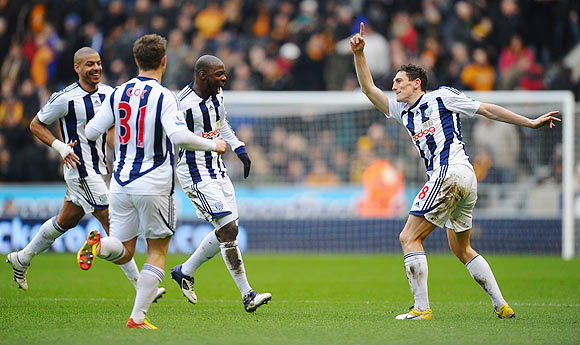 Keith Andrews (right) of West Bromwich celebrates with teammates after scoring against Wolves on Sunday