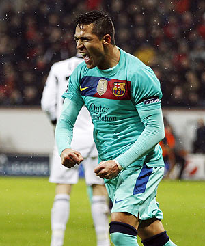 Barcelona's Alexis Sanchez celebrates a goal against Bayer Leverkusen during their Champions League match in Leverkusen on Tuesday