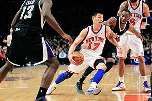 Jeremy Lin of the New York Knicks drives past Marcus Thornton of the Sacramento Kings during their NBA match at Madison Square Garden in New York City on Wednesday