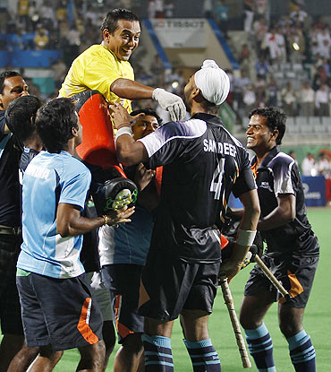 India's players hoist goalkeeper Bharat Kumar Chetri