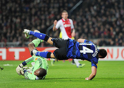 Goalkeeper Kenneth Vermeer of Ajax Amsterdam stops Javier Hernandez