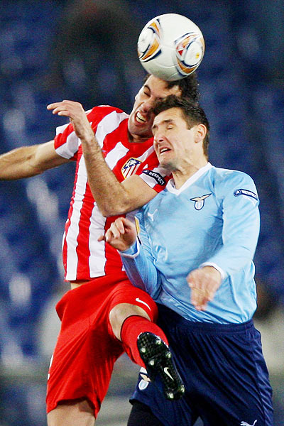 Diego Godin (left) of Club Atletico de Madrid competes for the ball