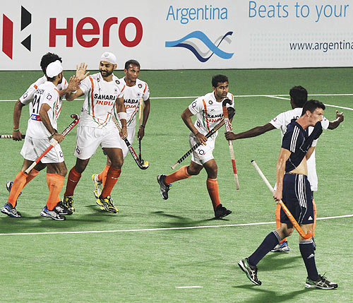 Sandeep Singh is congratulated by team-mates after scoring against France in the London 2012 Olympic Games men's hockey qualifying match in Delhi