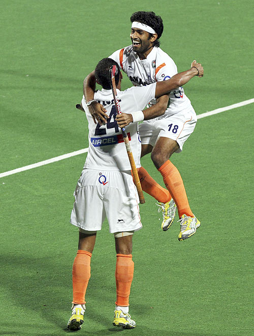 India's SV Sunil and Shivendra Singh celebrate a goal