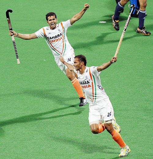 India's SV Sunil and Tushar Khandekar celebrate a goal