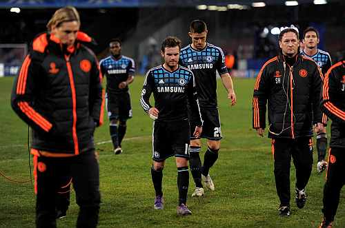 Chelsea players leave the field dejected after they were beat by Napoli during their Champions League last 16 first leg match at the San Paolo stadium