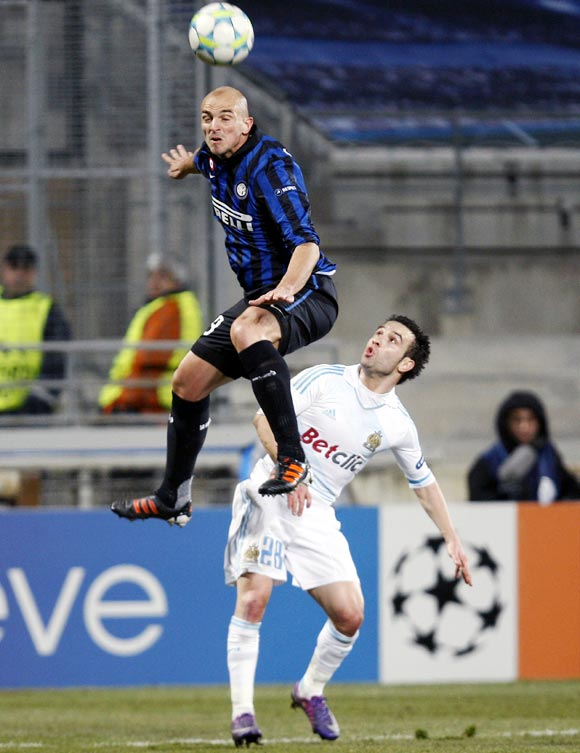 Olympique Marseille's Mathieu Valbuena (right) challenges Inter Milan midfielder Esteban Cambiasso